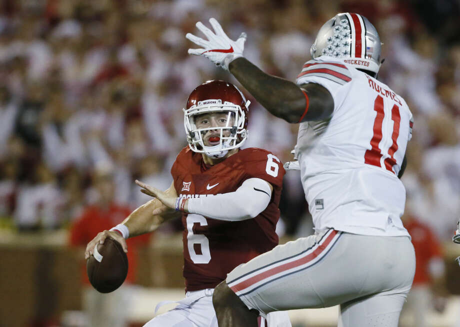 Oklahoma quarterback Baker Mayfield (6) is pressured by Ohio State defensive end Jalyn Holmes (11) during an NCAA college football game between Ohio State and Oklahoma in Norman, Okla., Saturday, Sept. 17, 2016. (AP Photo/Sue Ogrocki) Photo: Sue Ogrocki