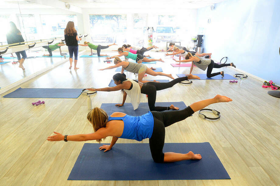 Mat pilates class at Lacy J Pilates taught by Lindsey Blanchard, Tuesday, June 14, 2016. James Durbin/Reporter-Tele­gram