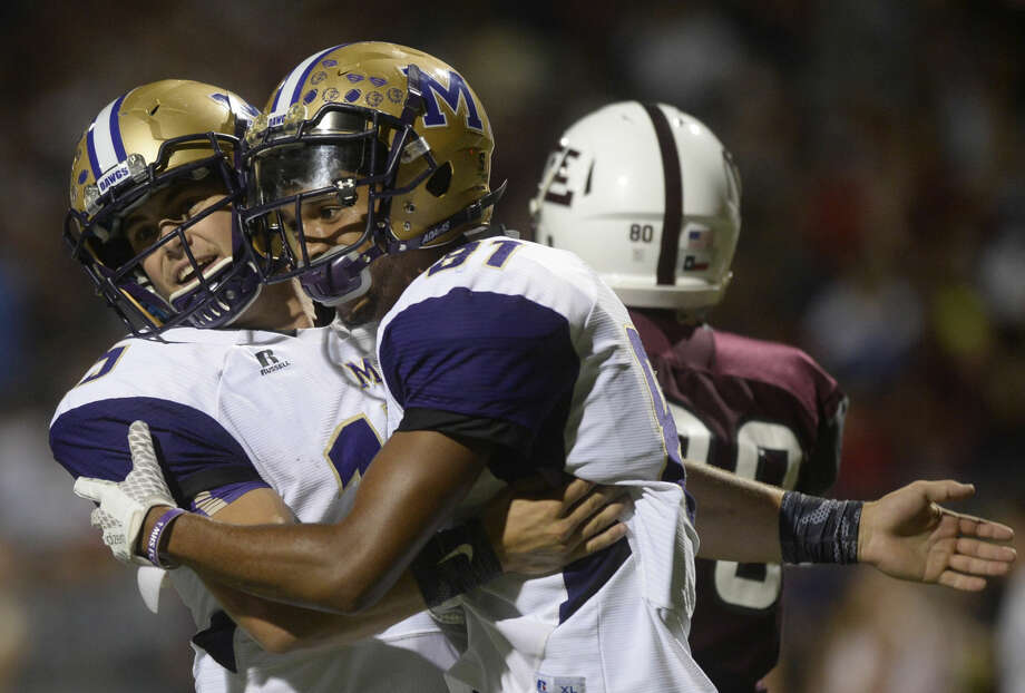 Midland High wide receiver Courtney McMaryion (right) celebrates a touchdown with quarterback Jackson Anuszkiewicz during the game against Lee on Friday, Sept. 23, 2016, at Grande Communications Stadium. James Durbin/Reporter-Telegram Photo: James Durbin