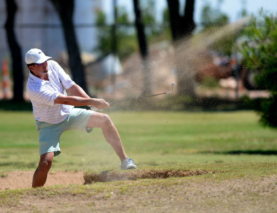 Braxton Dunaway hits out of a sand trap during the second day of the Blowout Golf Tournament on Saturday, July 30, 2016, at Ranchland Hills Golf Club. James Durbin/Reporter-Tele­gram Photo: James Durbin/Reporter-Telegram