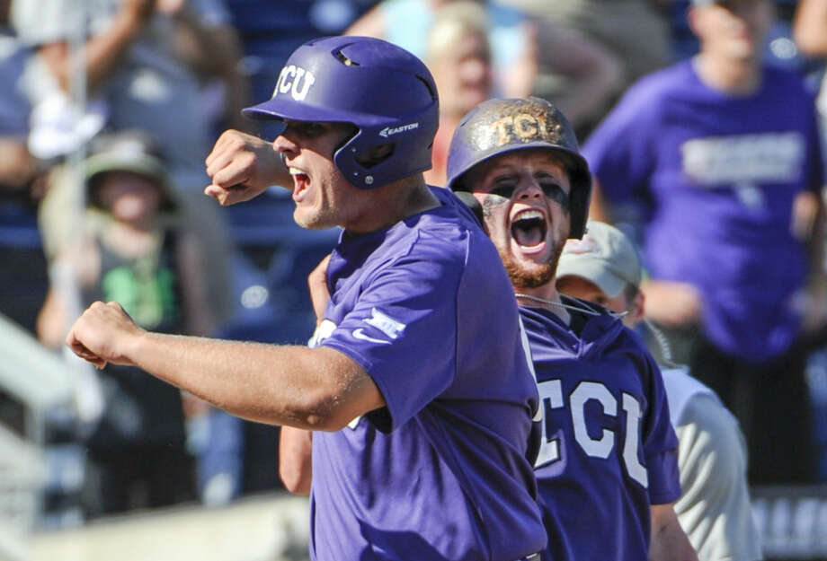 TCU's Luken Baker, left, celebrates at the dugout after hitting a three-run home run during the ninth inning of an NCAA men's College World Series baseball game against Texas Tech in Omaha, Neb., Sunday, June 19, 2016. TCU won 5-3. (AP Photo/Mike Theiler) Photo: Mike Theiler