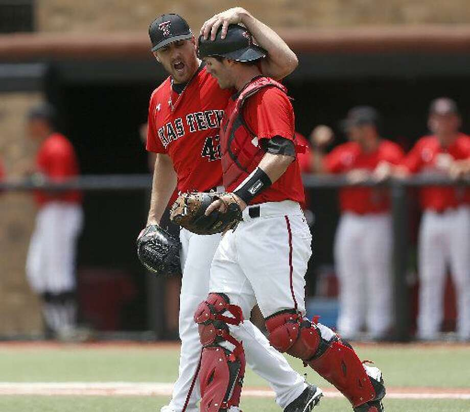 Texas Tech's Chris Sadberry (42) celebrates with Hunter Redman, right, after an out against College of Charleston during an NCAA college baseball tournament super regional game in Lubbock, Texas, Saturday, June 7, 2014. Texas Tech won 1-0. (AP Photo/Lubbock Avalanche Journal, Shannon Wilson)