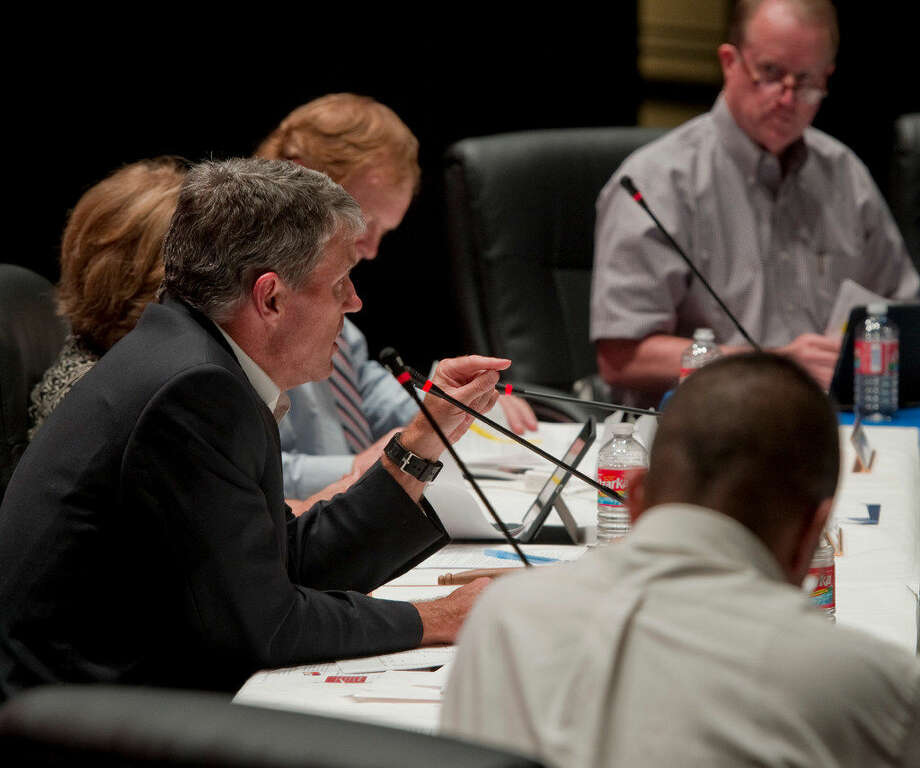 Midland schoolboardmembers discuss and vote on setting August 8 as a publicmeetingto discuss a proposed budget and tax rate increase during theboardmeetingMonday 07-25-16. Tim Fischer/Reporter-Telegram