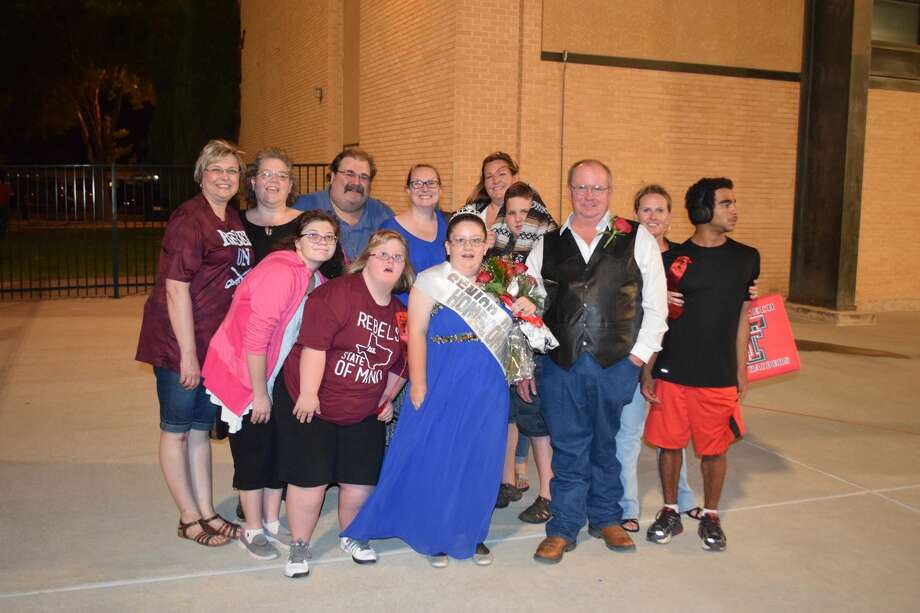 Iraan High School homecoming queen Olivia Hartman, and her dad, Kevin Hartman, second from right, are surrounded by friends from Midland who know the Hartmans through SHARE. Photo: Courtesy Photos