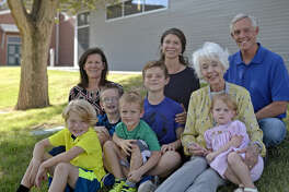 Wes Perry (far right) and wife Roni (far left) sit with mother Ricki Perry, and the children and grandchildren, totaling four generations of Midlanders with a connection to Bowie Fine Arts Academy and Midland schools. Photographed Friday, Sept. 23, 2016 at Bowie Fine Arts Academy.James Durbin/Reporter-Telegram