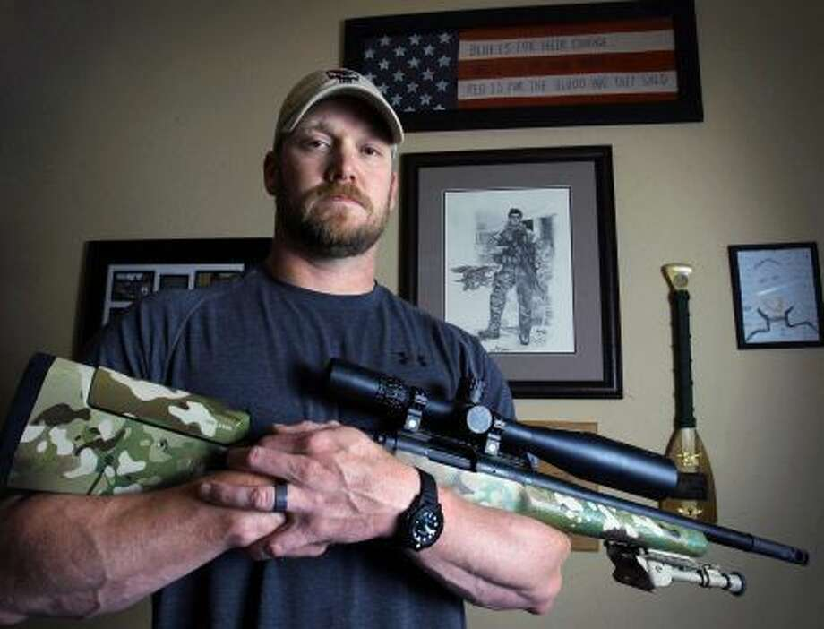 "In this April 6, 2012, file photo, Chris Kyle, a former Navy SEAL and author of the book ""American Sniper,"" poses in Midlothian. The Chris Kyle Memorial Plaza is being unveiled Thursday in Odessa. Photo: AP File Photo"