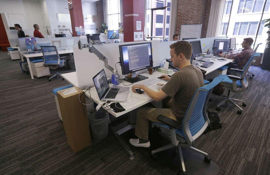 FILE- This Sept. 19, 2013, file photo shows workers at the Target Technology Innovation Center office in San Francisco. According to a survey by Fidelity Investments, millennials between the ages of 25 and 34 are saving a median of 7.5 percent of their pay for retirement, including whatever match they get from their jobs. (AP Photo/Jeff Chiu, File) Photo: Jeff Chiu