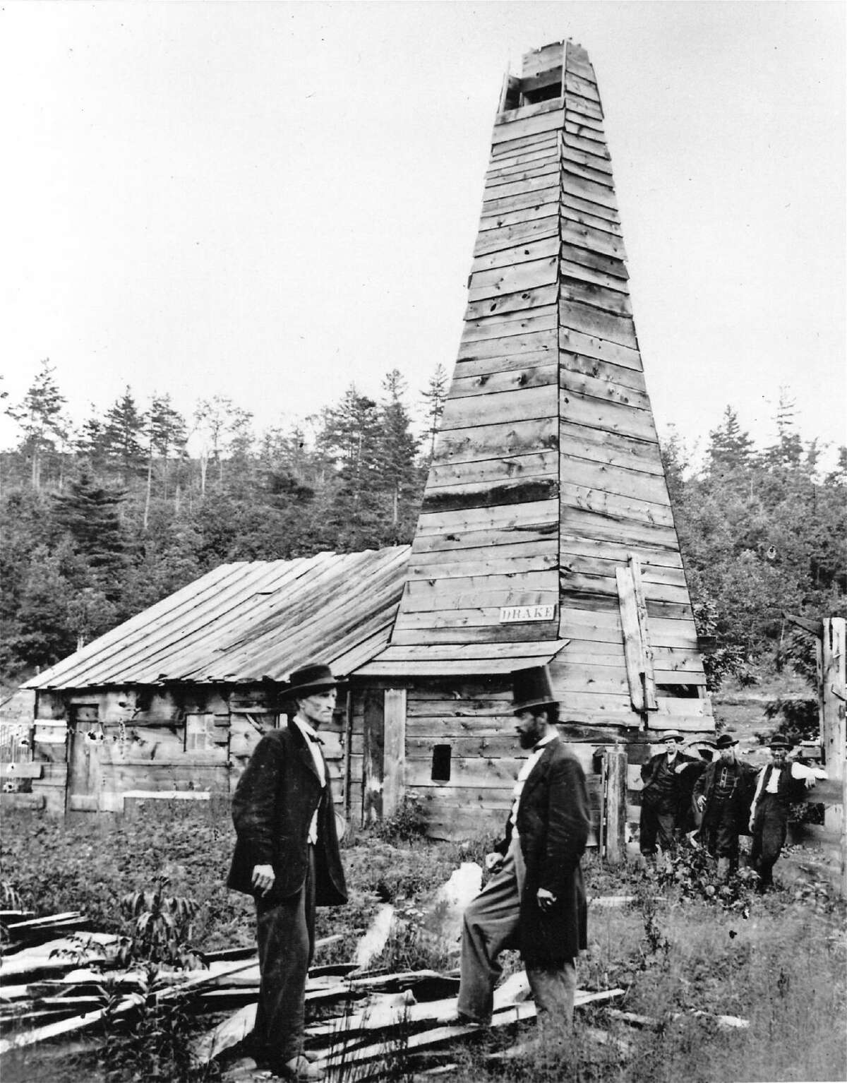 DW676 - Edwin L. Drake (right) in front of the Drake Well engine house in 1861.