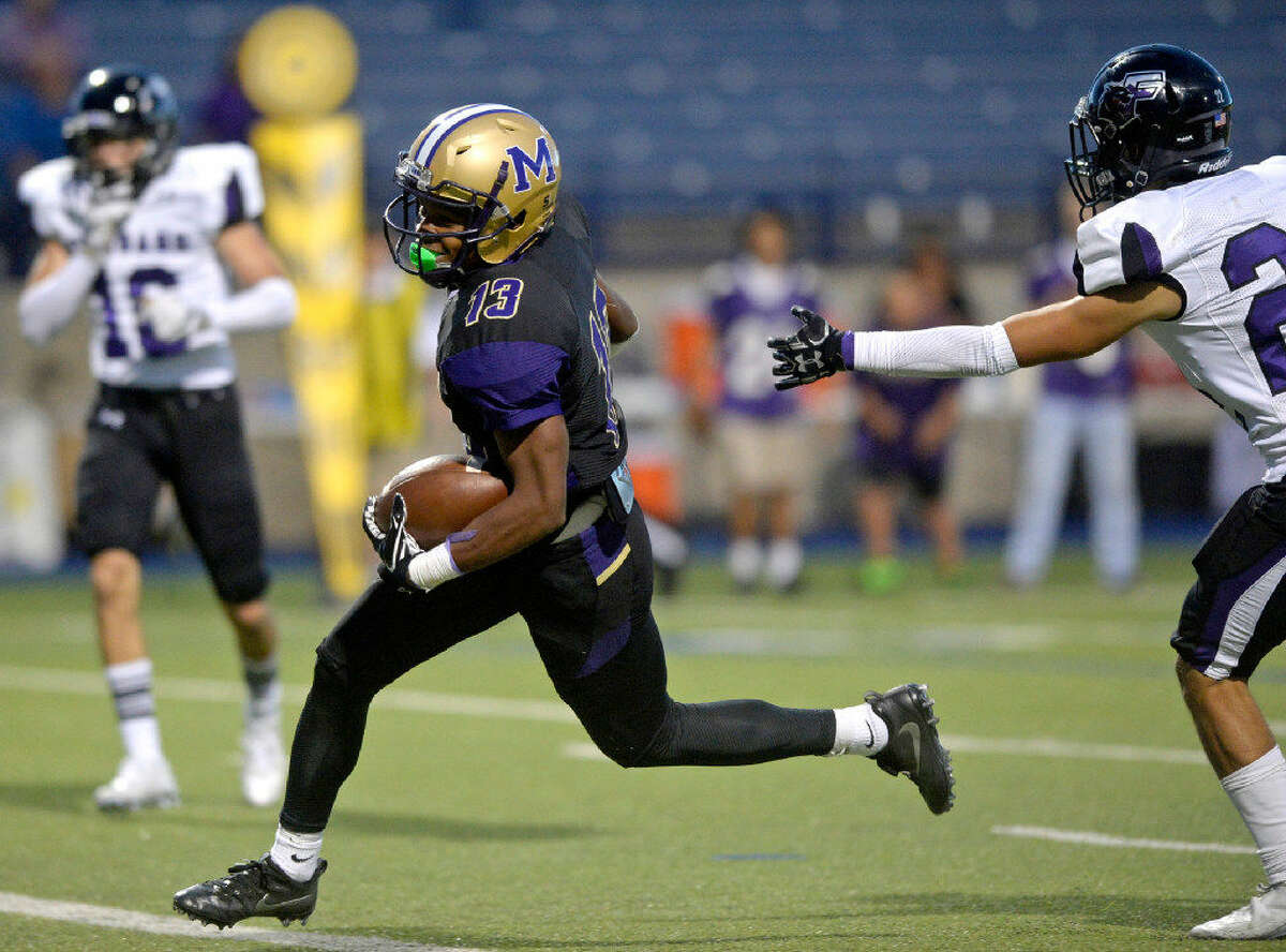 Midland's Juleion Bowers (13) runs past El Paso Franklin's Marc Feste (22) for a touchdown in the season-opening game Thursday, Aug. 25, 2016, at Grande Communications Stadium. James Durbin/Reporter-Telegram