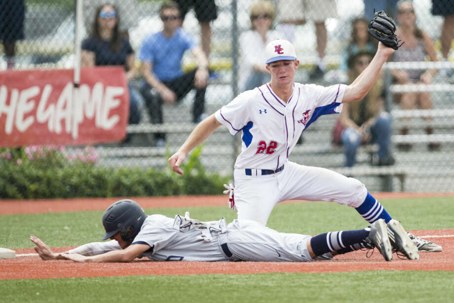Second Baptist's Grayson Skweres slides safely past Midland Christian third baseman Matthew Morgan (22), advancing to third on a single by Matthew Williams during the Class 4A TAPPS state baseball championship game at Baseball USA on Wednesday, May 25, 2016, in Houston. Second Baptist beat Midland Christian 7-2 for the title. ( Brett Coomer / Houston Chronicle ) Photo: Brett Coomer