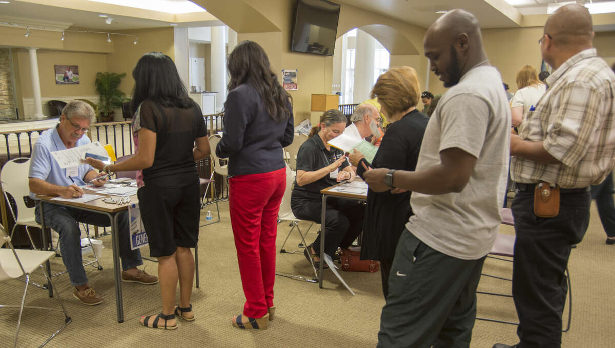 Potential employees line up to try to get a job Thursday 08-25-16 during the Poverty Simulation class at Golf Course Road Church of Christ. Tim Fischer/Reporter-Telegram