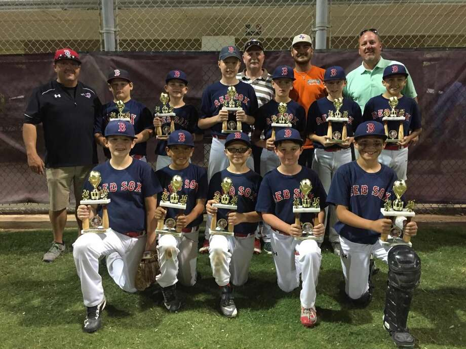 The Northern Red Sox are shown here after winning the American League City Championship on Thursday with an 11-7 over the Northern Rangers at Beal Park.