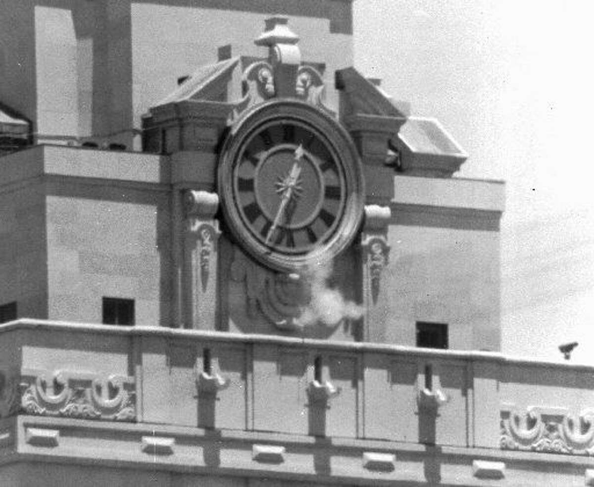 Location:University of Texas at Austin Date:August 1, 1966 # of deaths:18 Classification: In this photo:** FILE ** Smoke rises from a sniper's gun as he fires from thetowerof the University of Texas administration building on crowds below in this August 1, 1966, file photo. Until the carnage at Virginia Tech Monday, April 16, 2007, the 1966 sniping rampage by Charles Whitman from the Austin school's landmark 307-foottowerhad remained the deadliest campusshootingin U.S. history. (AP Photo)