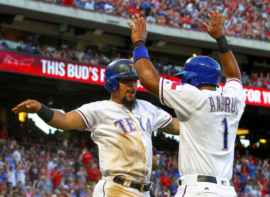 The Texas Rangers' Rougned Odor and Elvis Andrus (1) celebrate after they scored on a single by Bobby Wilson in the third inning against the Boston Red Sox at Globe Life Park in Arlington, Texas, on Friday, June 24, 2016. (Richard W. Rodriguez/Fort Worth Star-Telegram/TNS) Photo: Richard W. Rodriguez/Fort Worth Star-Telegram/TNS