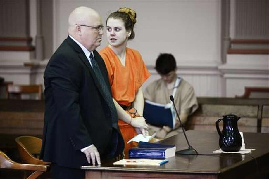 Emile Weaver, center, standing next to her attorney Aaron Miller, left, looks toward the gallery while addressing the court during her sentencing Monday, June 27, 2016, in Muskingum County Common Pleas Court in Zanesville, Ohio. Muskingum County Common Pleas Judge Mark Fleegle sentenced Weaver to life in prison without parole for disposing of her newborn baby in a trash bin outside the Delta Gamma Theta sorority house on campus. Weaver, 21, was found guilty by a jury last month of aggravated murder, abuse of a corpse and tampering with evidence. (Chris Crook/Times Recorder via AP, Pool)