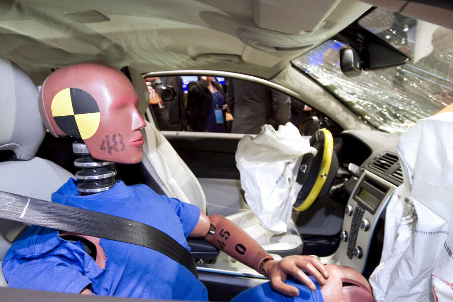 A 2011 photo shows a crash test dummy in a Volvo vehicle at the North American International Auto Show (NAIAS) in Detroit. The rise of Uber, Lyft and a new car-sharing economy that has more people riding in the back seat has regulators giving more attention to safety issues in rear seats. MUST CREDIT: Bloomberg photo by Jeff Kowalsky. Photo: Jeff Kowalsky