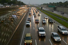 Traffic slows as rain falls during rush hour traffic on Interstate 30 in West Fort Worth, Texas, Tuesday, May 31, 2016. Residents of some rural southeastern Texas counties were bracing for more flooding along a river that reached a record-high crest on Tuesday but could swell further with more rain expected in the coming days. (Max Faulkner/Star-Telegram via AP) MAGS OUT; (FORT WORTH WEEKLY, 360 WEST); INTERNET OUT; MANDATORY CREDIT