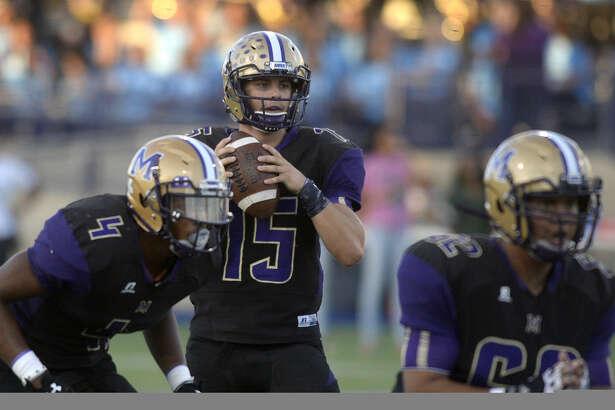 Midland's Jackson Anuszkiewicz takes the snap against DeSoto on Friday, Sept. 9, 2016, at Grande Communications Stadium. James Durbin/Reporter-Telegram