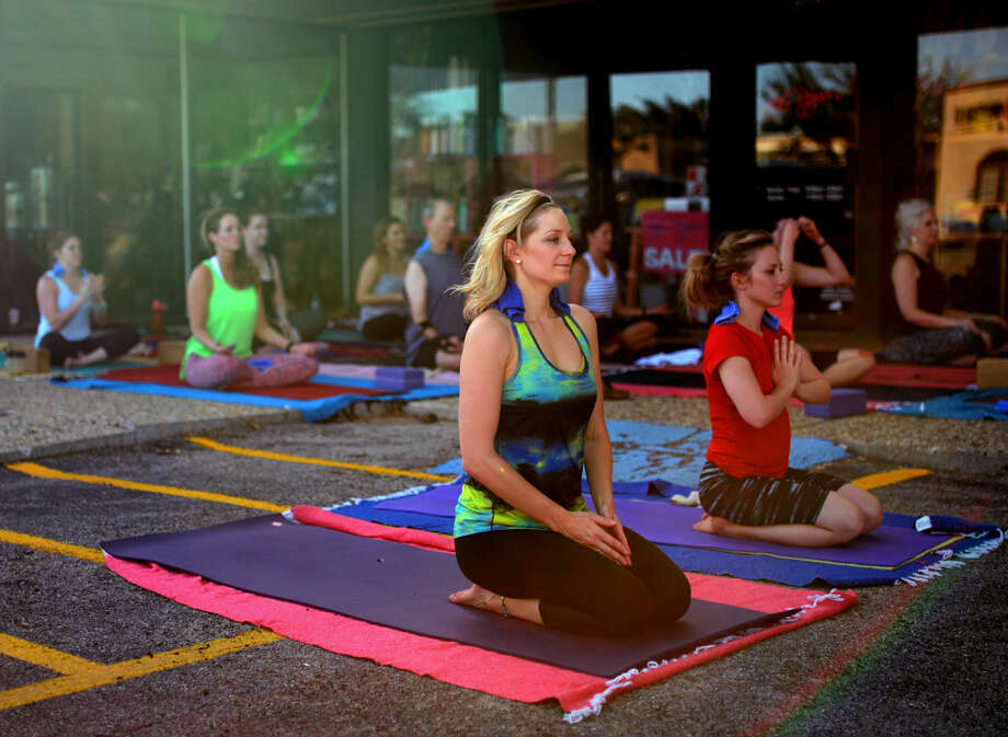 Free yoga class led by Cyndi Simpson in observance of International Yoga Day outside Midland Yoga Works on Tuesday, June 21, 2016. James Durbin/Reporter-Telegram Photo: James Durbin