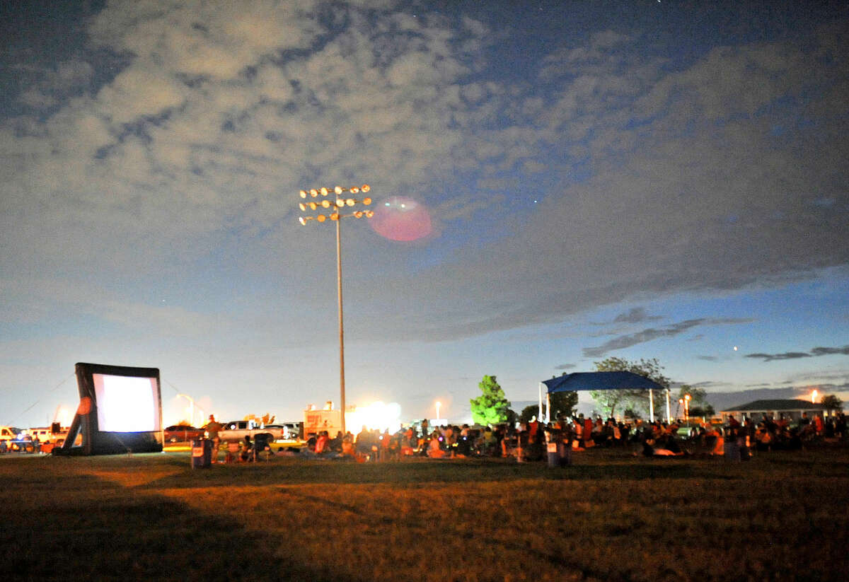 """Midlanders gathered to watch the movie """"Hotel Transylvania 2"""" on an inflatable screen Friday, Aug. 19, 2016, at Beal Park. James Durbin/Reporter-Telegram"""