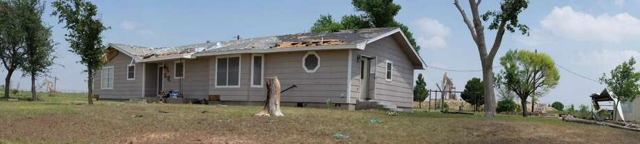 Pedro Flores' roof was damaged by the tornado that came through Glasscock County Sunday night Photo: Erin Stone