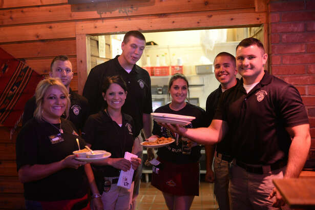 File Photo: Police officers and Law Enforcement Torch Run participants served tables and interacted with members of the community to raise money for Special Olympics Texas at Texas Roadhouse. James Durbin/Reporter-Telegram