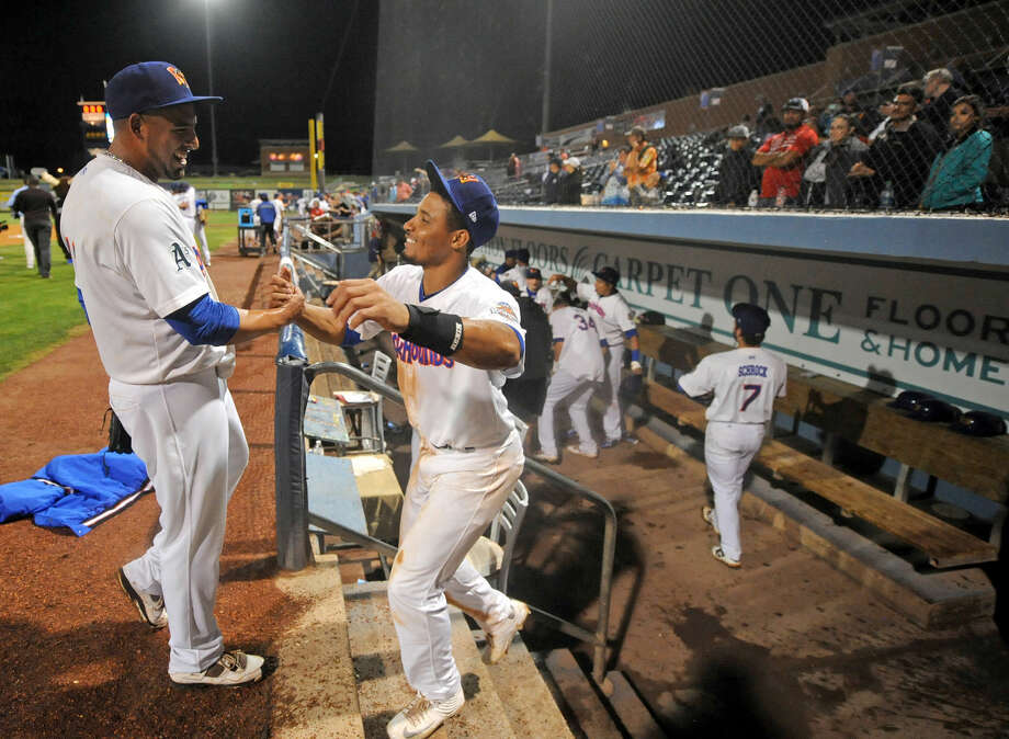 RockHounds' closing pitcher Jake Sanchez (left) is congratulated by shortstop Richie Martin (right) after beating Northwest Arkansas to win the Texas League Championship series on Friday, Sept. 16, 2016 at Security Bank Ballpark. James Durbin/Reporter-Telegram Photo: James Durbin