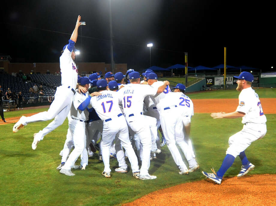 RockHounds players rush the field to celebrate beating Northwest Arkansas in the Texas League Championship series on Friday, Sept. 16, 2016 at Security Bank Ballpark. James Durbin/Reporter-Telegram Photo: James Durbin