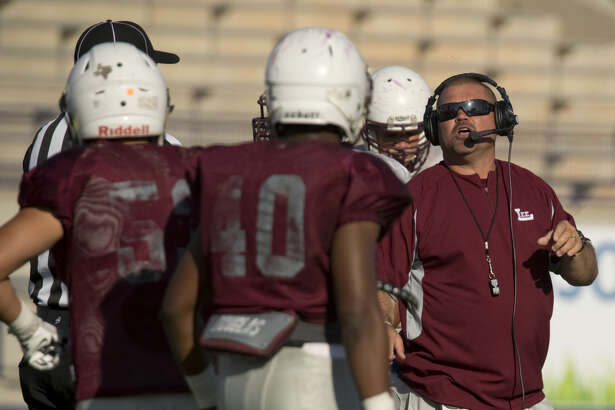 Midland Lee football head coach Clint Hartman works with his players Friday 05-27-16 at Grande Communications Stadium during the Spring Game. Tim Fischer\Reporter-Telegram