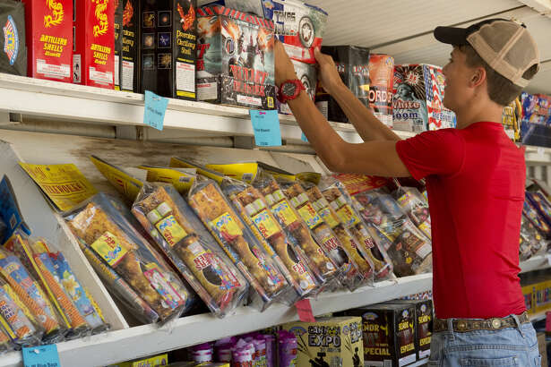 Midland High's JROTC Cadet Basic Dalton Walker and other members of JrROTC staff the Mr. W's Fireworks stand off Rankin Hwy Wednesday 06-29-16 as part of their annual fundraiser. Tim Fischer\Reporter-Telegram