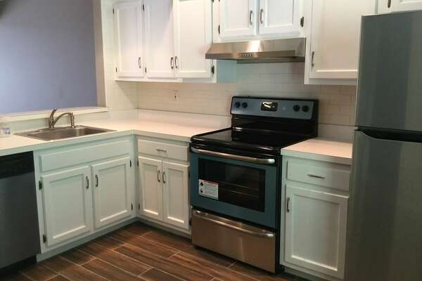 The townhouse at 166 Old Brookfield Road in Danbury for $1,750 a month. It includes a living room with dining area, kitchen with breakfast counter, new stainless steel appliances and new tiles, laundry room with washer and dryer, and AC/heat pump.
