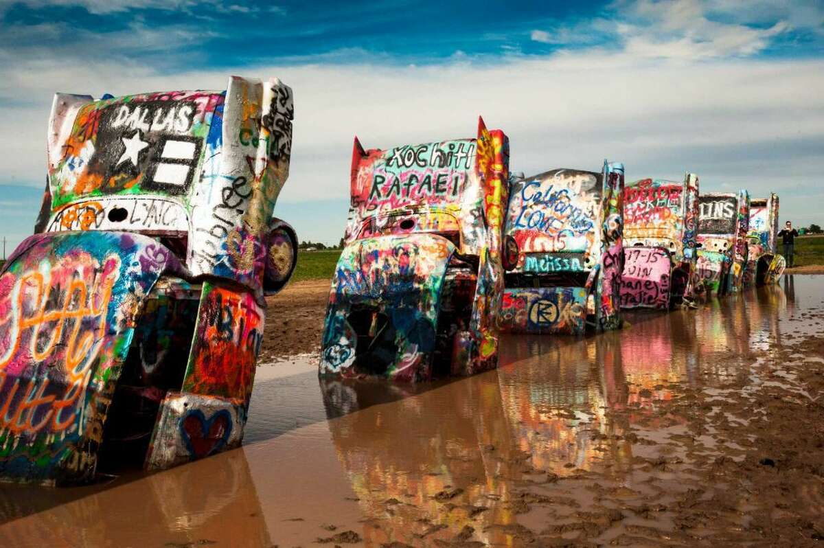 Cadillac Ranch13651 I-40 Frontage Rd. Amarillo, TX 79124 Created in 1974 by Chip Lord, Hudson Marquez and Doug Michels, the Cadillac Ranch consists of ten Cadillacs buried nose-first in the ground. Most visitors bring their own spray paint to leave their mark on their favorite Cadillac.