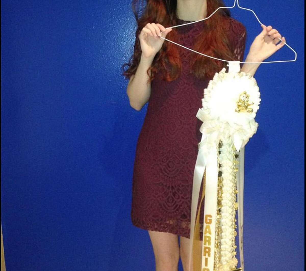 A student in Pearland wasn't allowed to wear this dress to Homecoming because the hemline was more than 3 inches above her knee.