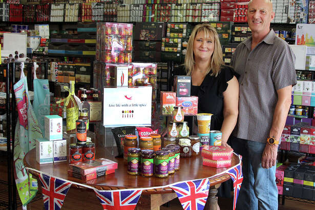 UK Gourmet owners Lisa and Nigel Whitmore stand in their store's new location at 78 Stony Hill Road in Bethel on Friday, Sept. 23, 2016.