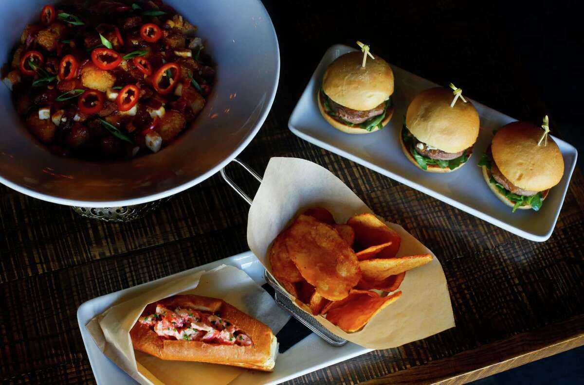 From top left: loaded tater tots, Angus sliders and a lobster roll at iPic