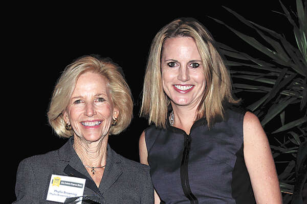 Phyllis Browning Co. founder and CEO Phyllis Browning (above left) and daughter Jennifer Shemwell, company president, accept an award when Phyllis Browning Co. was named a Top Workplace in 2015.
