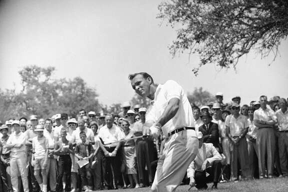 "This April 29, 1962, file photo shows Arnold Palmer, lifting an iron shot from No. 5 fairway in the final round of the Texas Open in San Antonio. Palmer, who made golf popular for the masses with his hard-charging style, incomparable charisma and a personal touch that made him known throughout the golf world as ""The King,"" died Sept. 25, 2016, in Pittsburgh. He was 87."