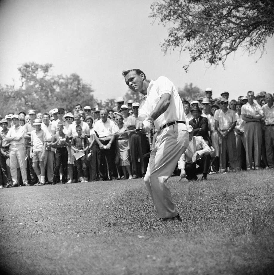 "This April 29, 1962, file photo shows Arnold Palmer, lifting an iron shot from No. 5 fairway in the final round of the Texas Open in San Antonio. Palmer, who made golf popular for the masses with his hard-charging style, incomparable charisma and a personal touch that made him known throughout the golf world as ""The King,"" died Sept. 25, 2016, in Pittsburgh. He was 87. Photo: Ted Powers /Associated Press / 1962 AP"