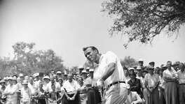 Arnold Palmer lifts an iron shot from No. 5 fairway in the final round of the Texas Open in San Antonio on April 29, 1962.