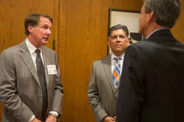 Texas Tech University Chancellor Robert Duncan, left, talks with Mayor Jerry Morales, center, and Tim Culp Sept. 19 before a luncheon at the Petroleum Club in Midland. The philanthropic gifts to the TTU System marks the highest fundraising total of Duncan's tenure as chancellor.