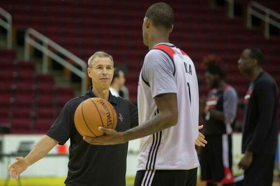 Houston Rockets assistant coach Jeff Bzdelik talks to Rockets forward Trevor Ariza during the team's first day of practice, Saturday, Sept. 24, 2016, at the Toyota Center in Houston. ( Marie D. De Jesus / Houston Chronicle )