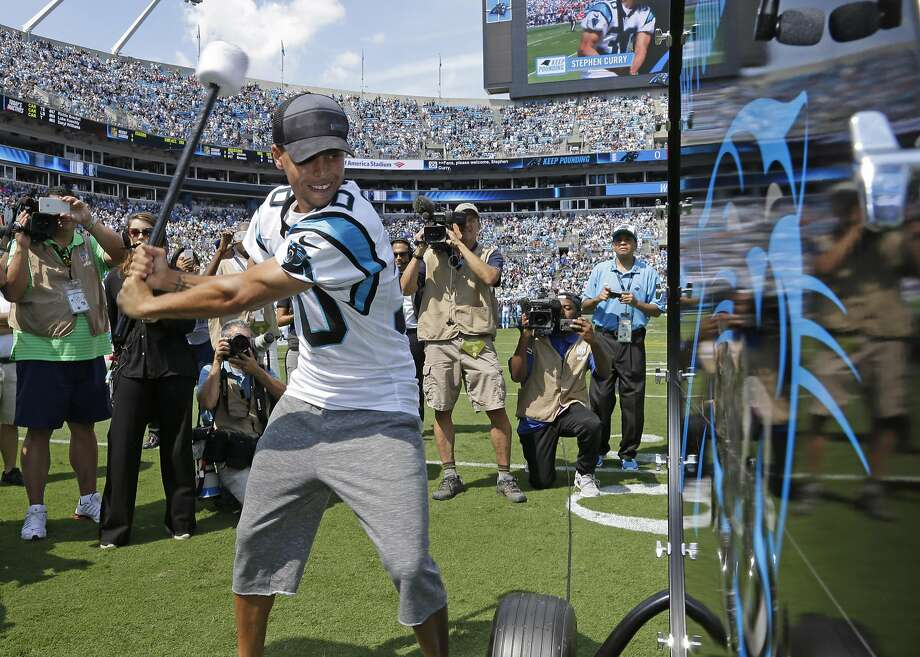 """FILE - In this Sept. 20, 2015, file photo, Golden State Warriors and NBA MVP Stephen Curry prepares to """"Pound the Drum"""" before an NFL football game between the Carolina Panthers and the Houston Texans in Charlotte, N.C. Curry will hit the """"Keep Pounding"""" drum for the Panthers at Super Bowl 50 on Feb. 7, 2016. (AP Photo/Bob Leverone, File) Photo: Bob Leverone, Associated Press"""