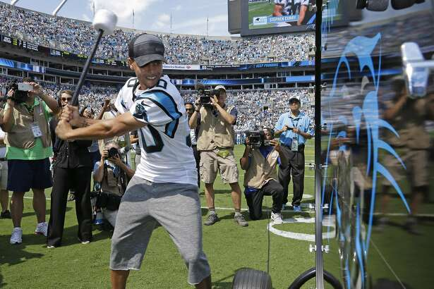 """FILE - In this Sept. 20, 2015, file photo, Golden State Warriors and NBA MVP Stephen Curry prepares to """"Pound the Drum"""" before an NFL football game between the Carolina Panthers and the Houston Texans in Charlotte, N.C. Curry will hit the �Keep Pounding� drum for the Panthers at Super Bowl 50 on Feb. 7, 2016. (AP Photo/Bob Leverone, File)"""