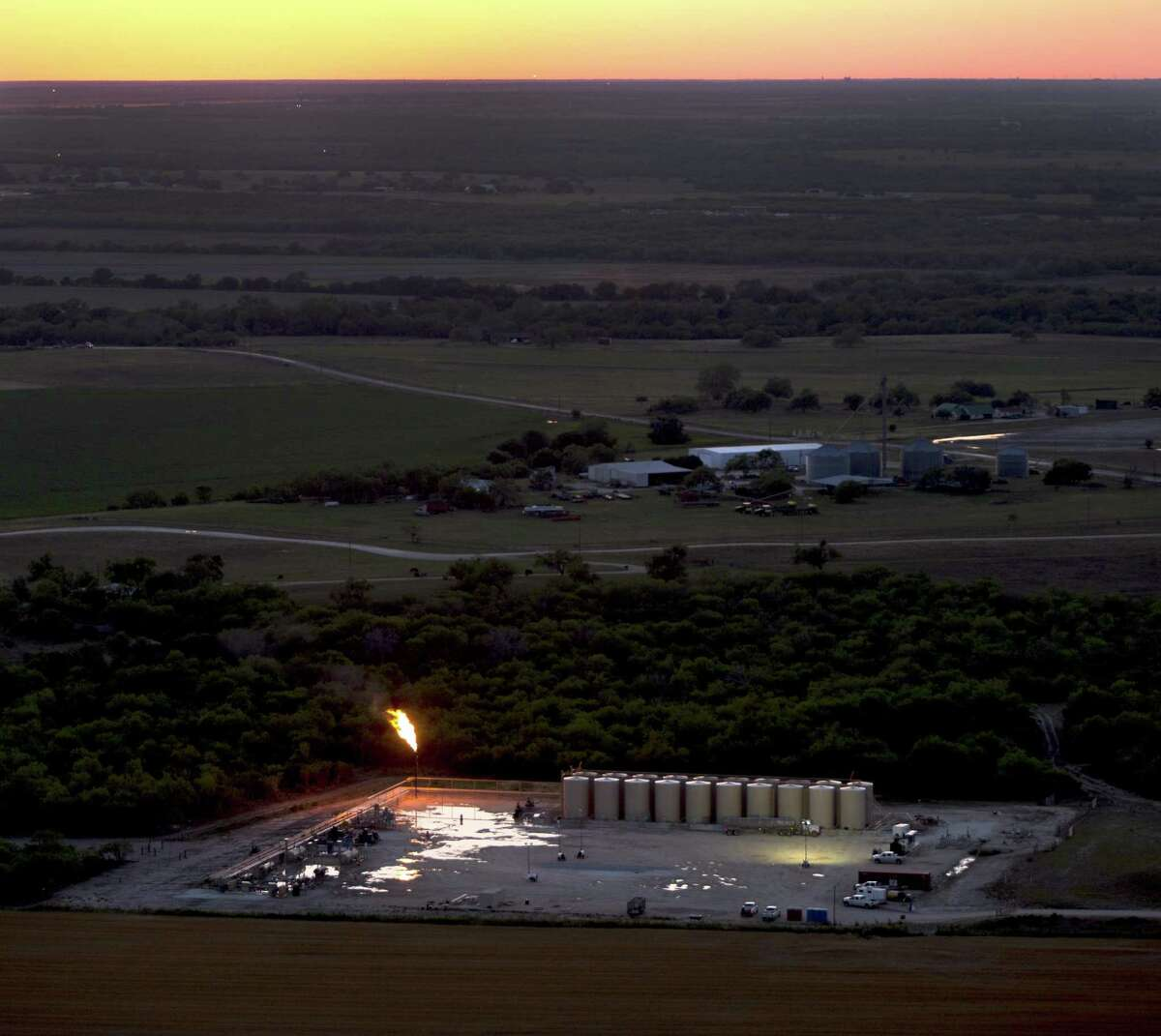 An oil production flare, also called a flare stack, is seen in a Wednesday, May 14, 2014 aerial image taken near Karnes City, Texas. The 400-mile Eagle Ford Shale continues to be among the busiest U.S. oil fields. The Eagle Ford pumps 1.2 million barrels of oil per day, and last week 70 drilling rigs were at work in the region, according to the service firm Baker Hughes.