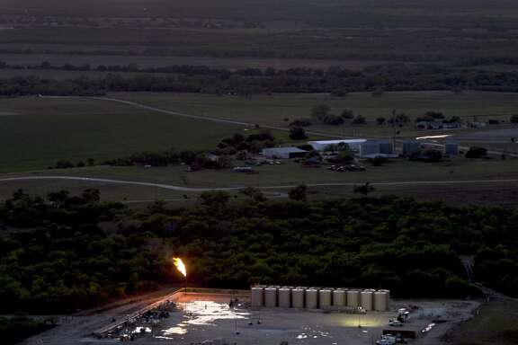An oil production flare, also called a flare stack, is seen in a Wednesday, May 14, 2014 aerial image taken near Karnes City, Texas. The U.S. oil industry looks healthy going into what's often a slow holiday season.