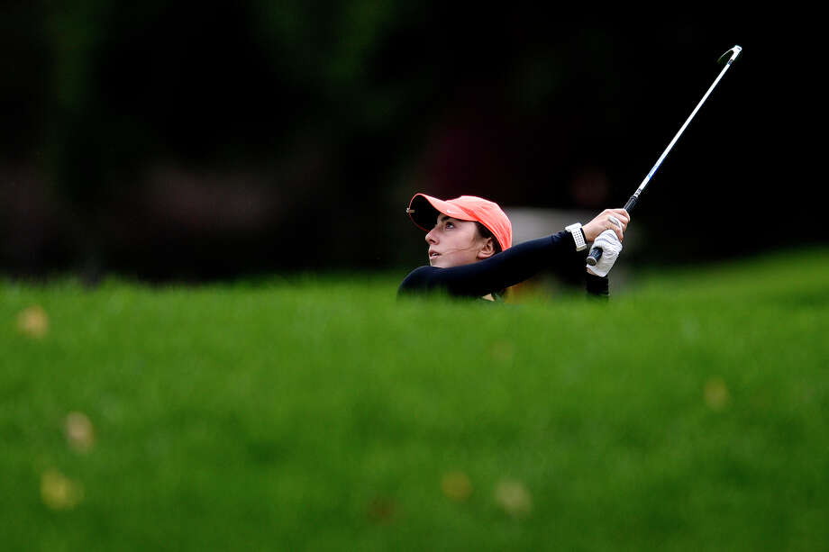 Dow High's Stephanie Carras hits onto the green on hole number 3 during her round of golf on Monday at the Midland Country Club. Photo: Nick King/Midland Daily News