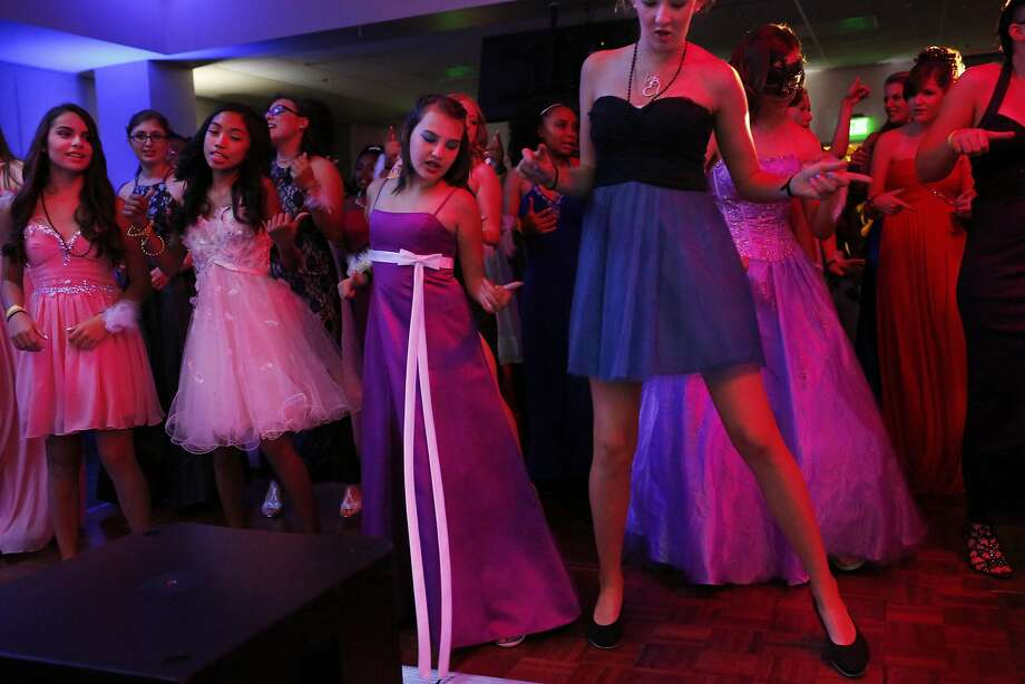 Isabel Cervantes (left), 13; Mailyna Mayate, 14; Nomi Solwren, 13; and Camryn Taft, 13, do the Cupid Shuffle on the dance floor. Photo: Leah Millis, The Chronicle