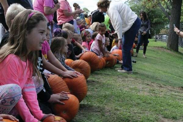 Kids await the go-ahead signal to push their pumpkins down the hill in the Caseville County Park Saturday. The event was part of the annual Caseville PumpkinFest.