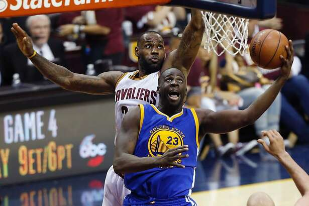 """(FILES) This file photo taken on June 8, 2016 shows Golden State Warriors forward Draymond Green(R)shooting the ball in front of Cleveland Cavaliers forward LeBron James (L) during Game 3 of the NBA Finals in Cleveland, Ohio. American basketball star Draymond Green's build-up to the Rio Olympics hit another snag July 31, 2016 after he had to apologize for posting a picture of his penis on social media. Green dismissed the incident by saying he pushed the wrong button which resulted in the photo being displayed for about 10 minutes on Snapchat before it was taken down. """"We are all one click away from placing something in the wrong place,"""" said Green, who will represent the USA at the Rio Summer Games in Brazil.  / AFP PHOTO / Jay LaPreteJAY LAPRETE/AFP/Getty Images"""