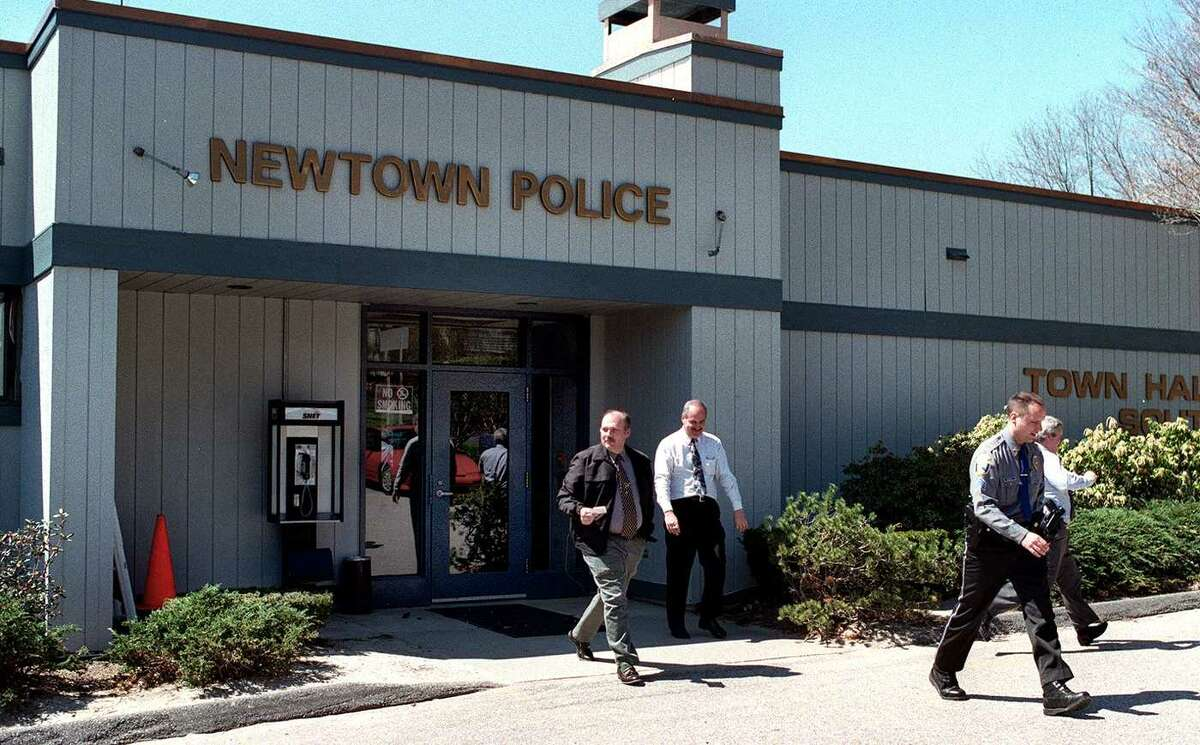 Detectives and a police sgt., leave the Newtown Police station, April 8 1999.